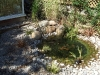 Wildlife pond created in a natural style with informal edges of cobbles and pebbles