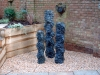 Natural stone carved stack water features, self contained circulating features